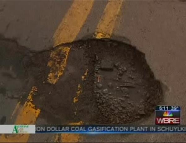 Pothole Patrol Busy as Weather Warms_4501904629132119458