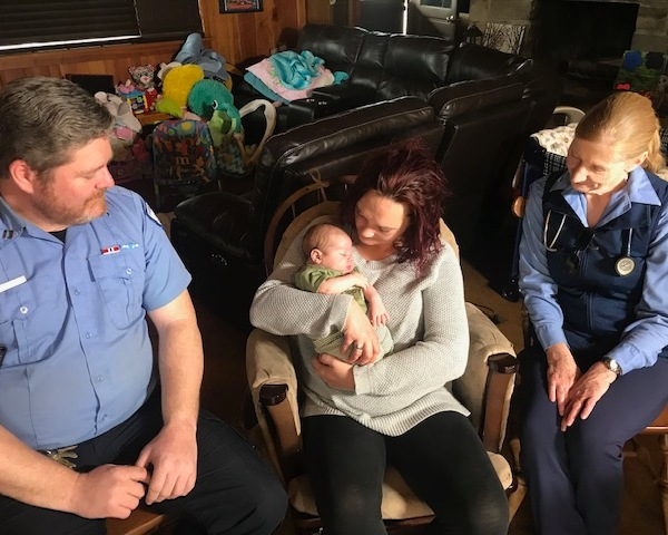 EMT Delivers Baby_1554846682051.jpg.jpg
